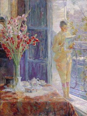 Interieur: jongen bij het raam